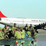 Taliban militants in front of hijacked IC-814 at Kandhar