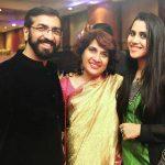 singer Nikhita Gandhi with her parents