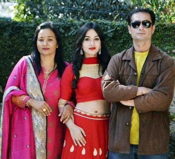 Aditi Budhathoki with her parents