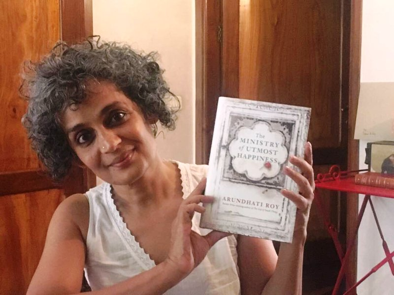 Arundhati Roy while posing with her book - The Ministry of Utmost Happiness
