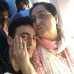 Ayaz Khan with his mother