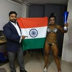 Bhumika Sharma Holding the Tricolour and Her Miss World Bodybuilding Trophy