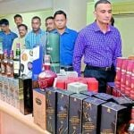 Excise Director Akun Sabharwal Shows Liquor Bottles Seized