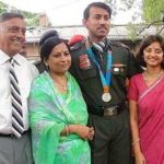 Rajyavardhan Singh Rathore with his parents and wife