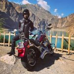 Umair Jaswal Standing By His Harley Davidson Custom 48 Sportster