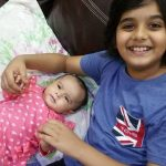 Uzair Basar with her younger sister