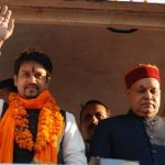 Prem Kumar Dhumal with his son Anurag Thakur