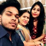 Nishant Koli with his mother and sister