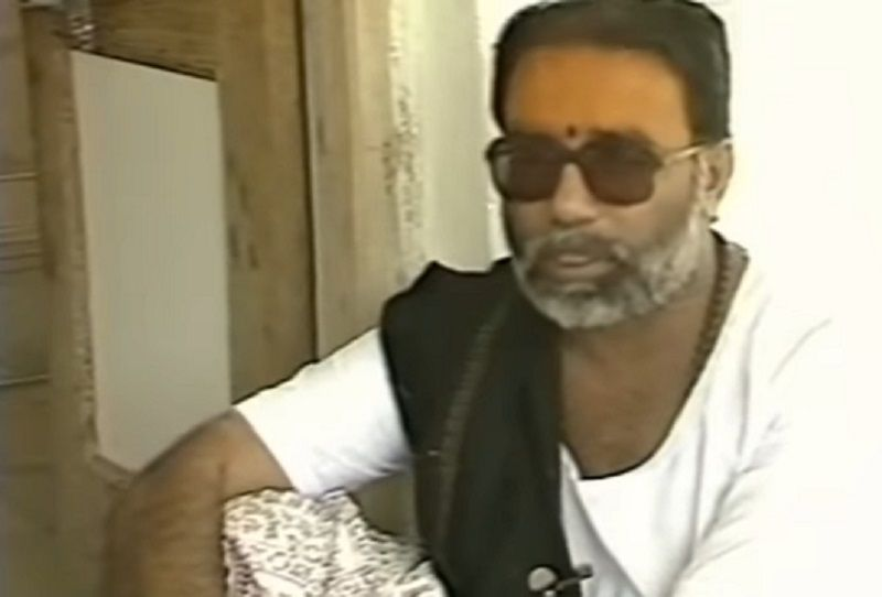 Morari Bapu Wearing Black Shawl and Black and White Shawl