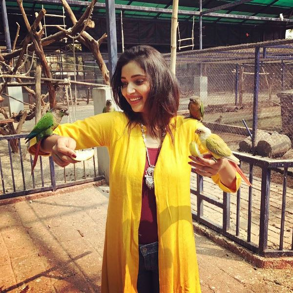 Rupali Bhosale Playing With Parrots
