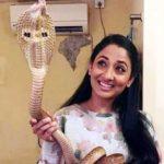 Shruti Ulfat posing with a Cobra snake