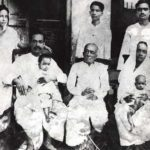 A. C. Bhaktivedanta Swami Prabhupada With His Family (1924), From Left His Wife Radharani (Standing), Swami Prabhupada (Sitting with His Son Prayag Raj), His Father Gaur Mohan De (Sitting), His Nephew Tulsi (Standing, Backside of Gaur Mohan De), His Sister Rajesvari With His Daughter Sulakshman (Sitting), His Brother Krishna Charan (Standing)