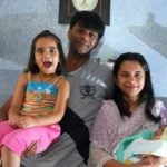 Tanmay Vekaria with his wife and children
