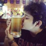 Ankita Mehra with a glass of beer
