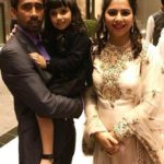 Romi Saha with her husband and daughter