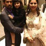 Romi Saha with her husband and daughter