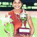 Young Sheethal Goutham with her winner's trophy (Tennis)