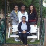 Regina Ramjit with her mother and sisters