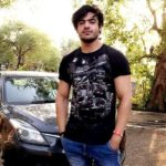 Sonu Jat with his Maruti Suzuki Baleno car