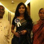 Usha Jadhav with her parents