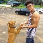Ankit Raizada with a street dog
