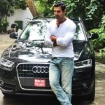 John Abraham With His Car Audi Q3