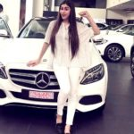 Myra Sareen poses with her Mercedes-Benz car