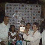 Ranveer Allahbadia receiving a trophy with his partner for Judo