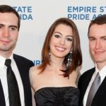 Anne Hathaway with her brothers
