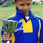 Dele Alli holding a trophy in his childhood