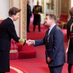 James Corden receiving OBE at Buckingham Palace, London