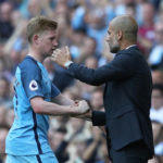 Kevin de Bruyne with his coach Pep Guardiola