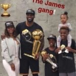 LeBron James with his wife and children