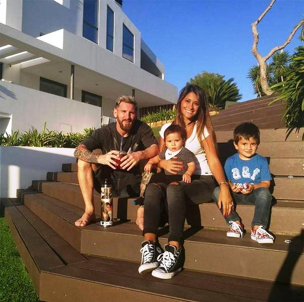 Lionel Messi with his family outside his home
