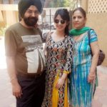 Neha Pawar with her parents