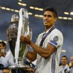 Raphael Varane with the 2017-2018 Champions League trophy