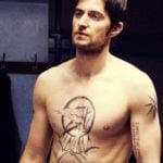 Richard Armitage showing off his tattoo