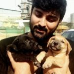 Samrat Reddy with his pet puppies