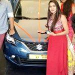 Sanjana Anne poses with her Maruti Suzuki Baleno car