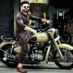 Basheer Bashi poses with his bike Royal Enfield