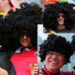 Marouane Fellaini's fans wearing Afro wigs