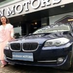 Pearle Maaney poses with her car BMW 520i
