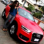 Ranjini Haridas poses with her car 'Audi Q3 Dynamic'