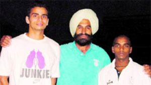 Arpinder Singh with his coach S. S Pannu in 2010