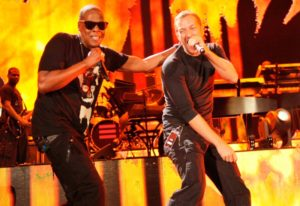 Chris Martin performing with Jay Z