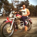 Devdatta Nage poses with his Royal Enfield bike