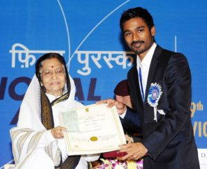 Dhanush receiving Rajat Kamal Award from former President Pratibha Patil