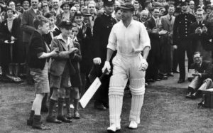 Don Bradman walks out to bat