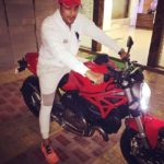 Gaurav S Bajaj poses with his Ducati Monster bike