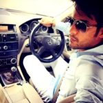 Gaurav S Bajaj poses with his Mercedes Benz car